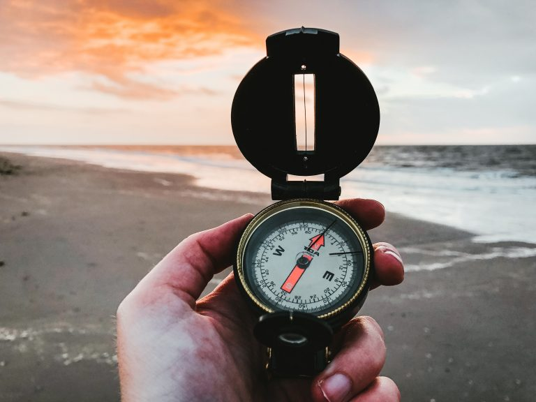 Compass in the beach